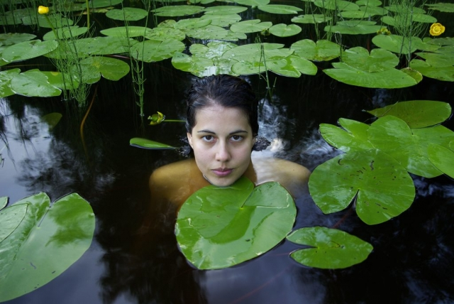Himani Grundström swiming among water lilies